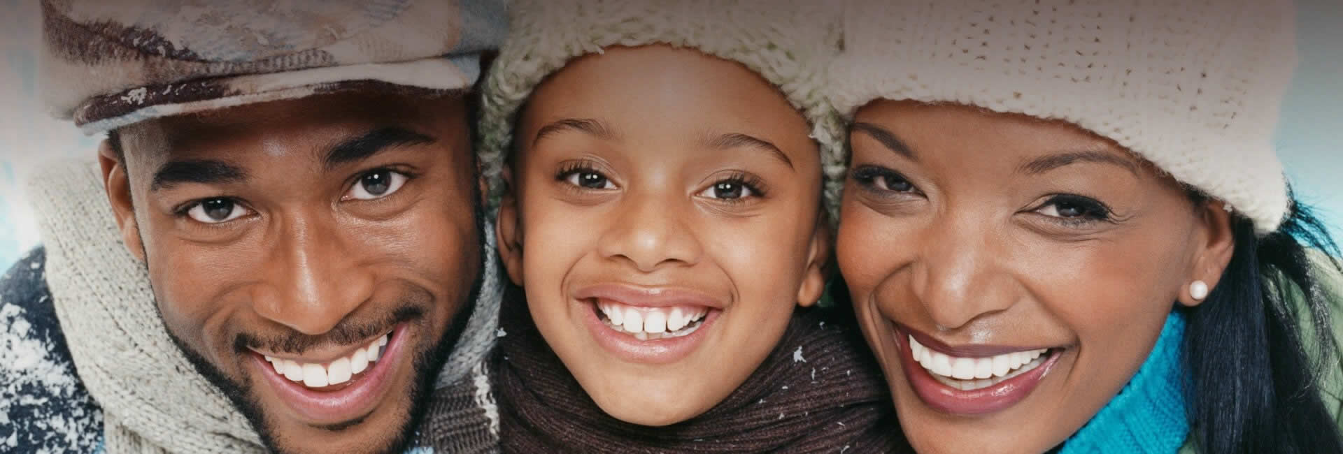 A smiling family with healthy teeth