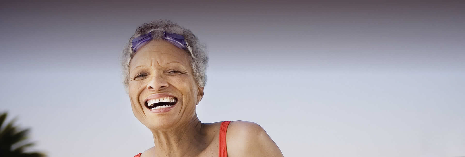 A very happy old woman with healthy teeth